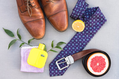 Groom's details with citrus, shoes, and tie.