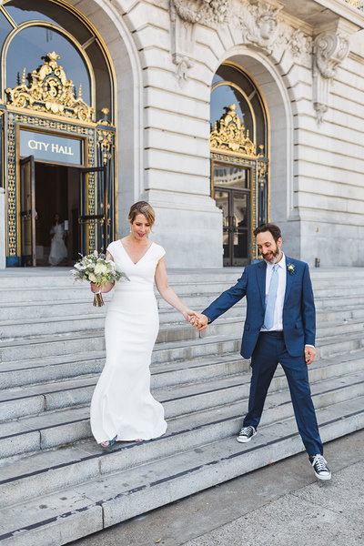 couple exiting San Francisco City Hall by Zoe Larkin Photography