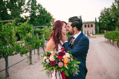 Bride and groom kissing in the vineyards at Casa Rondena Winery in Albuquerque