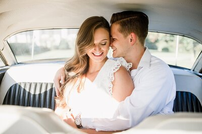 Couple cuddling in car backseat by Knoxville Wedding Photographer Amanda May Photos