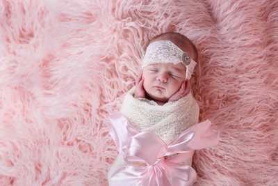 Beautiful Mississippi Newborn Photography:newborn girl wrapped in ivory, pink and pearls