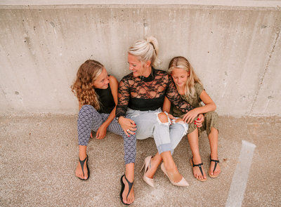 mom and two daughters laughing