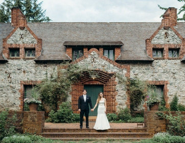 Grass Valley Wedding Planners couple holding hands in front of Bourne Cottage at venue Empire Mine State Park Grass Valley,  Joy of Life Events image by Kris Holland Photography
