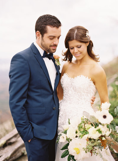 Fall Bride in Lace Dress with Garden Bouquet with Groom in Navy Blue Tuxedo