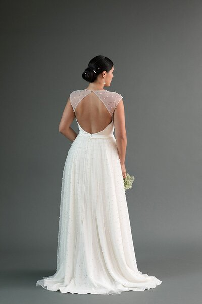 Back view of the Chika wedding dress with its keyhole back and pearl details