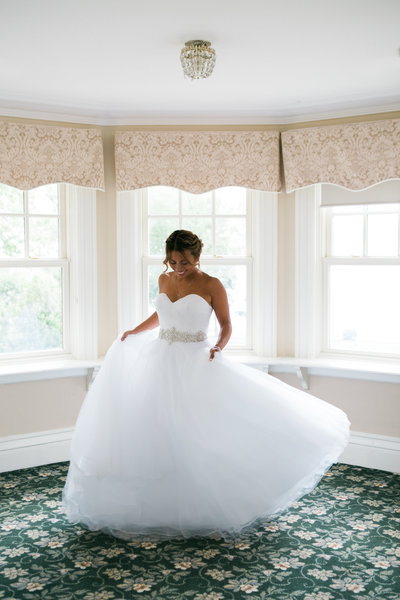 Burlington-wedding-photographer-bride-spinning-in-wedding-dress-at-paletta-mansion