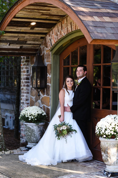 Couple in front of Greengates Farmhouse in Laural, MS
