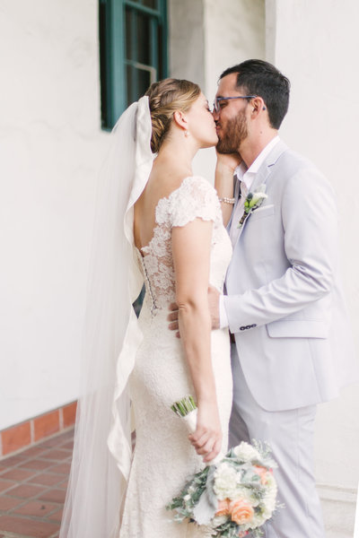 Bride kisses groom after elopement at Santa Barbara Courthouse
