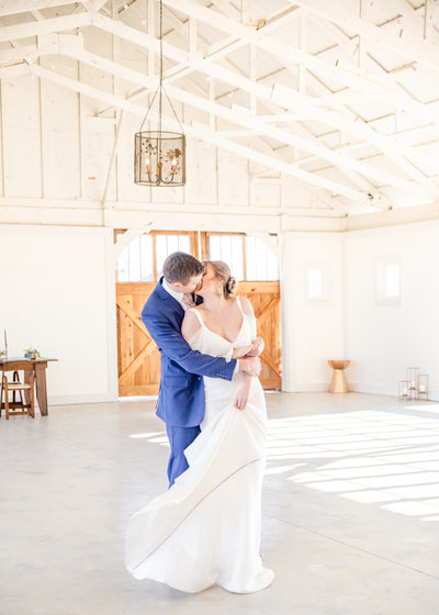 Bride and groom dancing at barn wedding venue