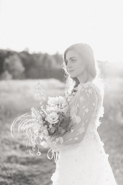 Image of a Maine wedding with a bride in a field