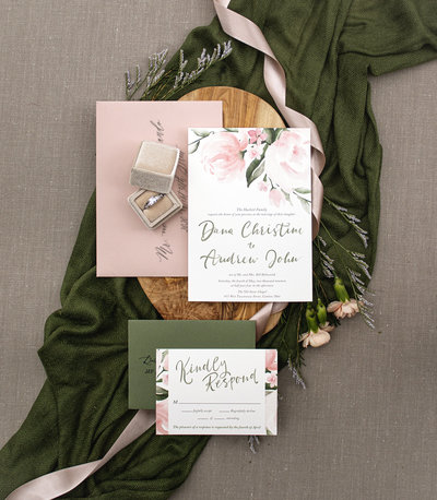Hand-painted watercolor wedding invitation featuring soft-pink blooming peonies and quaint watercress flowers.