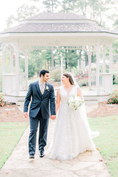 bride and groom walking from a gazeebo looking at each other by atlanta wedding photographer lane albers photography