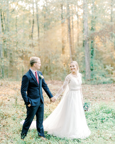 Couple walking hand in hand at their classic southern wedding - photo by Corey Johnson Studios Highlands Wedding Photographer