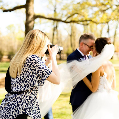 Photographer and bride and groom at white sparrow barn
