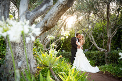 Wedding couple kissing at Rancho Valencia in San Diego