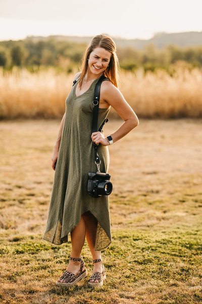 woman smiling with camera