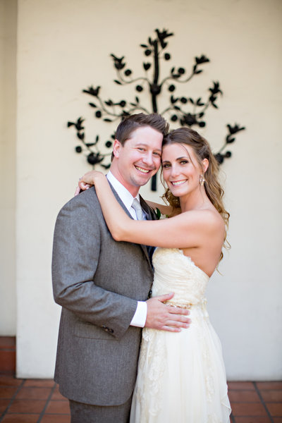 Bride and Groom hugging at ceremony site at The Darlington House San Diego wedding venue