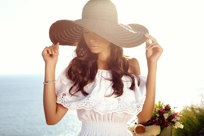 stock photo - elegant brunette sundress and hat ocean