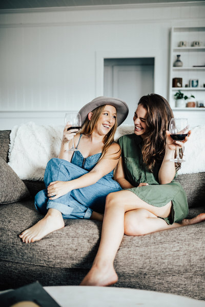 girls laughing on couch