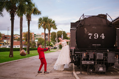 two brides posing for a photo on a train at Sunset Station wedding venue in downtown San Antonio