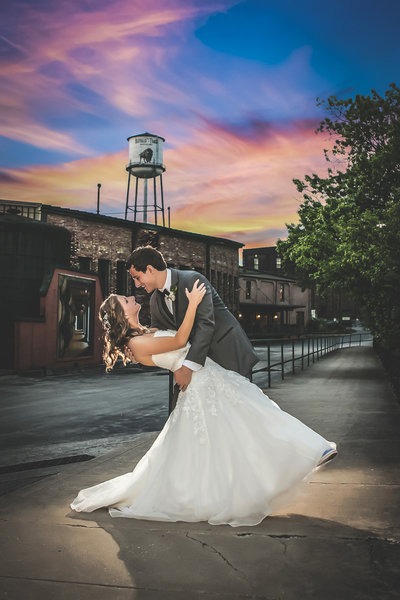Kentucky Groom dips Bride at Buffalo Trace Distillery at sunset in bourbon country.