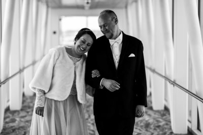 Bride and groom walk the skybridge together at the Sheraton Erie Bayfront Hotel
