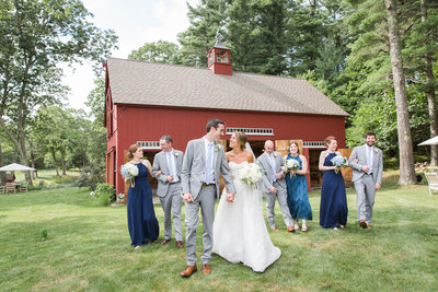 Bridal Party celebrates with photos at red barn in Duxbury