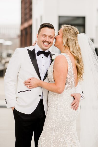bride whispering to groom by Knoxville Wedding Photographer, Amanda May Photos