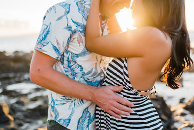 Couple embraces to celebrate their anniversary on Maui by Mariah Milan photographers.