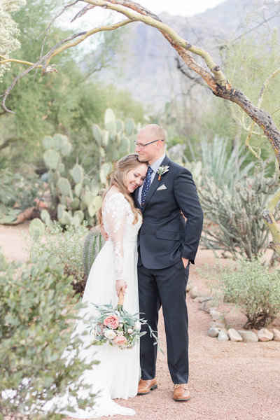 Bride and groom pose for a photo in Phoenix