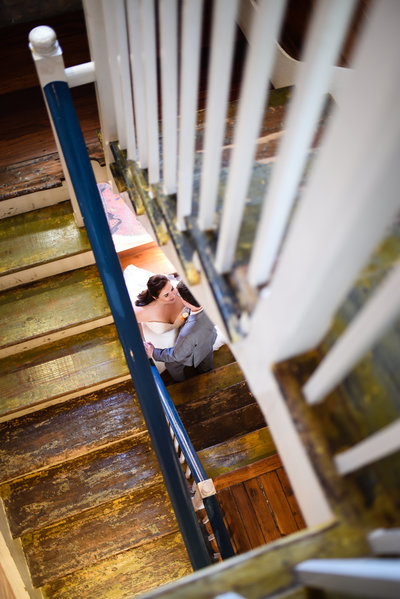Couple through the staircase at Race and Religious, New Orleans Wedding