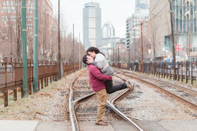 newly engaged couple on the green line of Boston