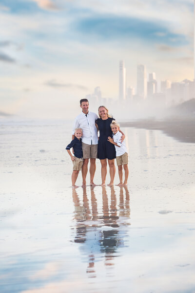 Natural light family portrait outdoors on beach at The Gold Coast
