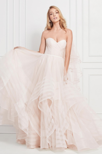 Formal on top, party on the bottom: we crisscrossed the bodice of this gorgeous gown for support and pumped up the volume of the skirt, so it moves like a dream.