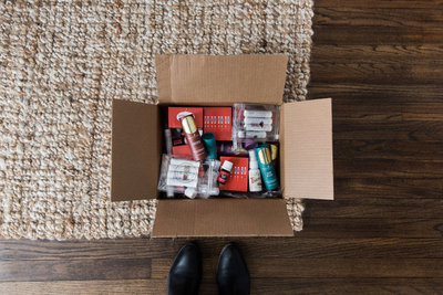 Open box filled with Young Living essential oils and natural goodies
