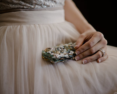 Bride with small clutch on Wedding Day, fine art bridal portraits by Erin Tetterton Photography