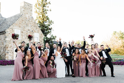 Summer wedding at Fiddler's Elbow Countyr club. Blush pink bridesmaid dresses and  burgundy bouquets.