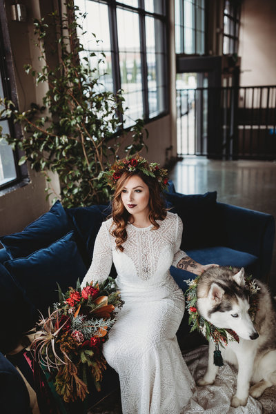 Winter bride with husky, dark and moody , lace wedding gown
