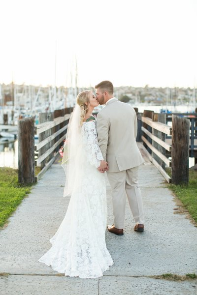Bride and Groom kissing in portrait at wedding at Bali Hai San Diego Wedding Venue