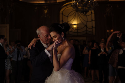 Father and daughter dancing at Claridges wedding. Modern wedding photographer