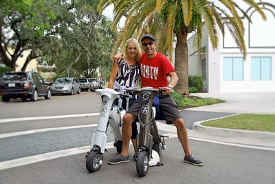 Honeymooners out for Sunday ride on Grey & White Go-bike M1