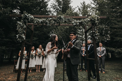 athena-and-camron-intimate-woodlands-bohemian-wedding-rain-kandice-federico-bride-groom-lead-worship-ceremony