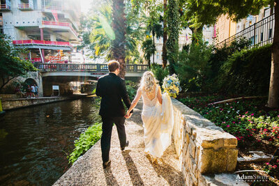 Bride and groom walking on San Antonio river walk