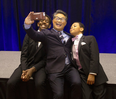 Attendees at gala take a selfie