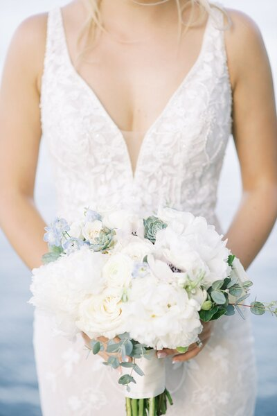 bride holding her bouquet at bella donna chapel by catie ann photography