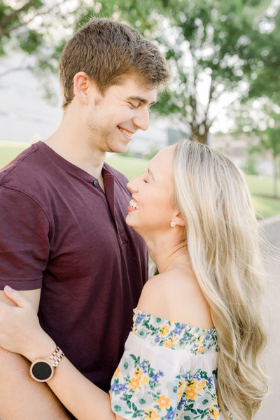 A couple facies each other and  laughs during an engagement session in Cincinnati, Ohio