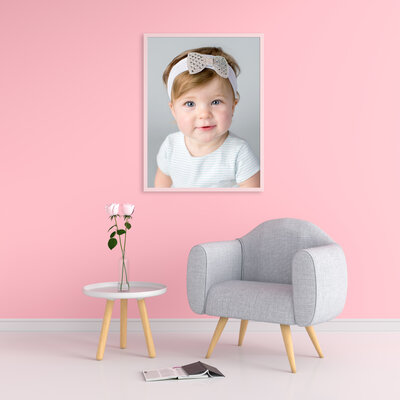 framed portrait of a baby girl in hew room