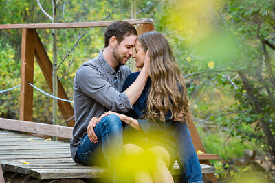 romantic-engagement-photos-on-bridge-fall-color-guanella-pass-colorado