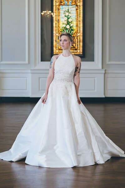 Model wears the modern lace ballgown wedding dress Karli from the 2018 Edith Elan bridal collection