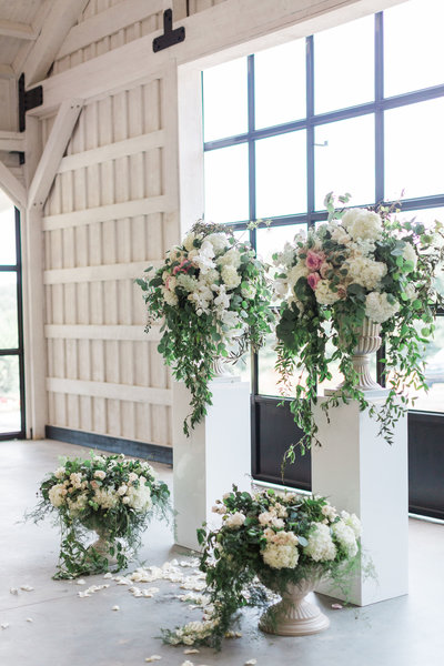 Garden style ceremony with pedestals
